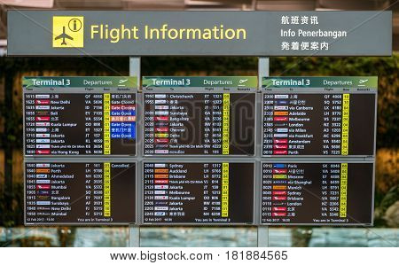 Singapore SINGAPORE - FEB 12 2017: Flight information board in Changi airport in Singapore showing various flight to international destination.