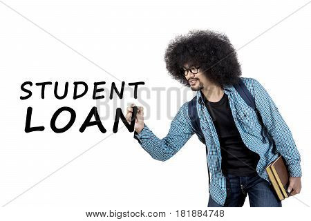 Young afro man writing student loan word on whiteboard while holding book isolated on white background