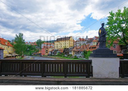 Cesky Krumlov, Czech Republic - May 2, 2012: Statue on Plastovy Bridge at the castle of Cesky Krumlov in Czech Republic.