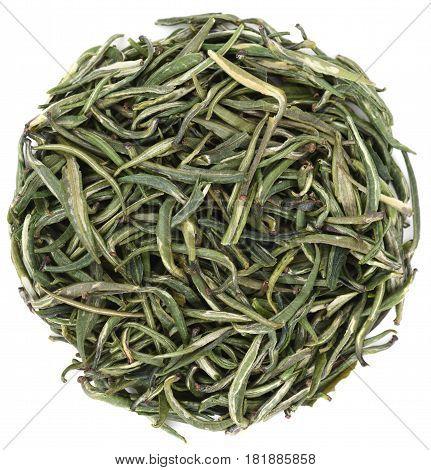 Organic green tea Zhu Ye Qing from Simao Yunnan in round shape isolated overhead view