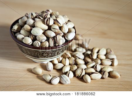 Bowl of pistachio nuts on a table