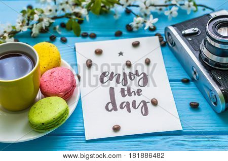 Stil life with macaroons and coffee on the wooden background