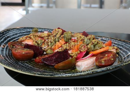 salmon tomatoes capers beetroot carrot & mustard dish