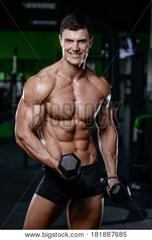 Strong And Handsome Athletic Young Man Muscles Abs And Biceps Fitness And Bodybuilding