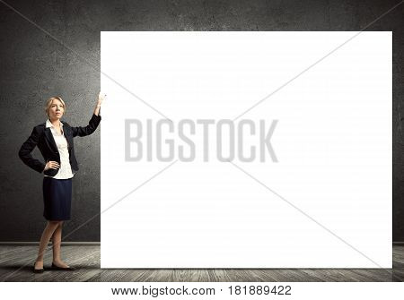 Fullbody of blond businesswoman with white blank banner