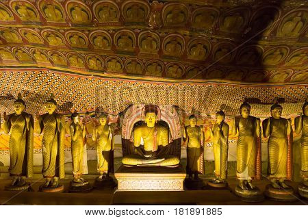 Ancient golden statues in buddha temple on Ceylon
