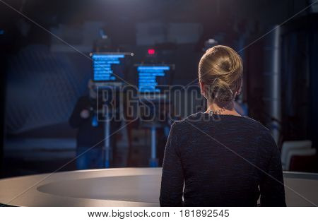 TV presenter - live broadcast in the evening