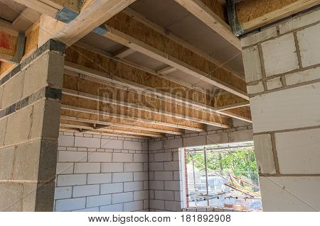 Room construction showing ceiling and roof joist trusses