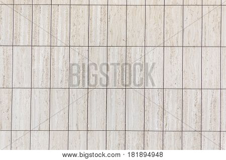 marble facade with rectangular tiles in harmonic pattern