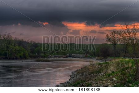 A spring storm rolling over the Des Moines river south of the Saylorville spillway