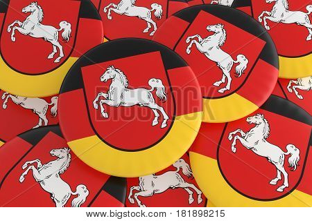 German States Badges: Pile of Lower Saxony Flag Buttons 3d illustration