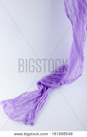 flowing drape soft purple fabric on white background. Vertical photo