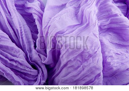 Nice background made of soft textile wrinkled purple scarf