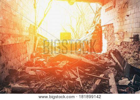 Inside an abandoned house, a ruined wall, can be used as demolition concept, sunlight filter
