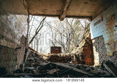 Inside an abandoned house, a ruined wall, can be used as demolition, earthquake, bomb, terrorist attack or natural disaster concept