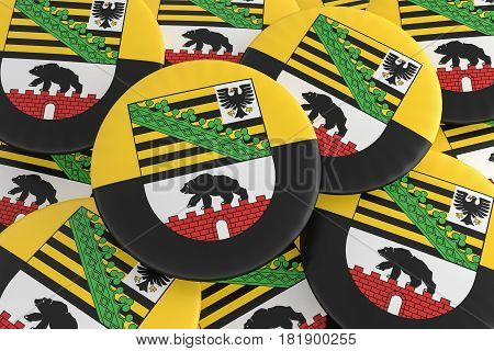 German States Badges: Pile of Saxony-Anhalt Flag Buttons 3d illustration