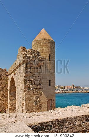 Tower and wall of the old town. Rhodes, Greece.
