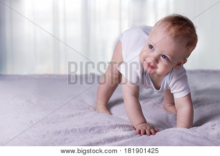 Cute Baby Boy Doing First Steps. Lovely Infant Kid Begining To Toddle