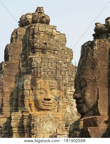 Stone faces carved into the Bayon temple at Angkor Thom, Cambodia