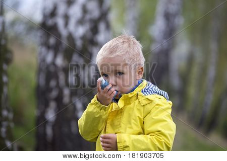 Child And Asthma Inhaler