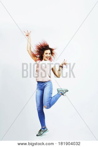 young pretty jumping mulatto woman posing cheerful emotional isolated on white background, lifestyle people concept close up