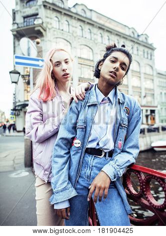 Two teenage girls infront of university building smiling, having fun, lifestyle real people concept close up