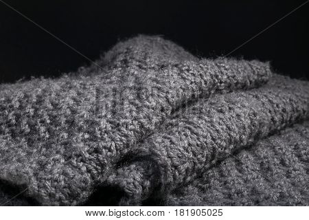 Knitted Isolated Folded Wool Fabric Background.