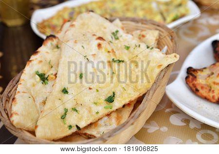 Garlic And Coriander Naan On A Basket