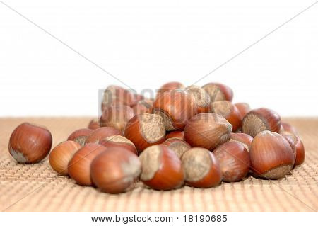 Nuts (hazelnuts) On The Table.