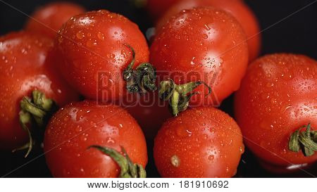 Extreme close-up view of tomatoes with water drops. Concept of healthy food.