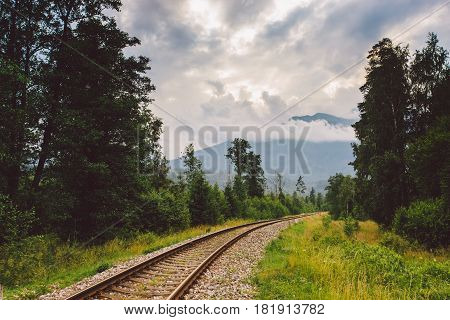 rails railroad mountains Slovakia sunset rails stretching to the horizon