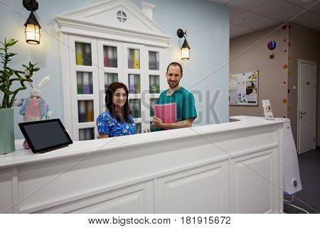 MOSCOW, RUSSIA - OCT 19, 2016: Doctor and registry female emloyee at reception desk in Children Medical Center Sanare for children of all ages from birth to 17 years old.