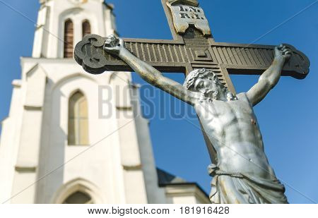 Jesus Christ statue in front of a church