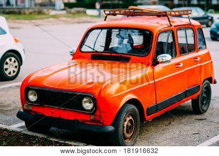 Red retro car in Montenegro, marks of Zastava, production of Yugoslavia.