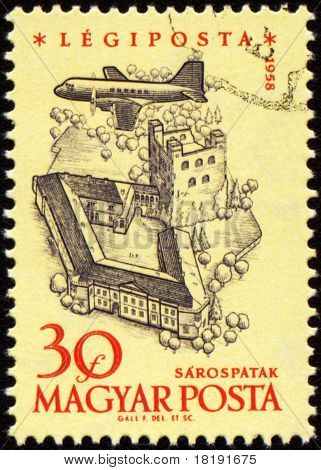 Flying Plane Over The Medieval Castle On Post Stamp