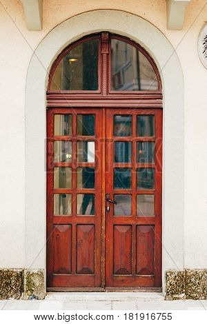 Old yellow, brown, red doors. Wood texture. Old shabby irradiated paint