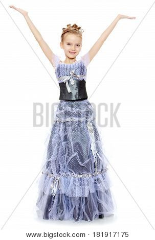 Slender little girl , with beautiful hair on his head, elegant long Princess dress.The girl raised her hands up and to the side.Isolated on white background.