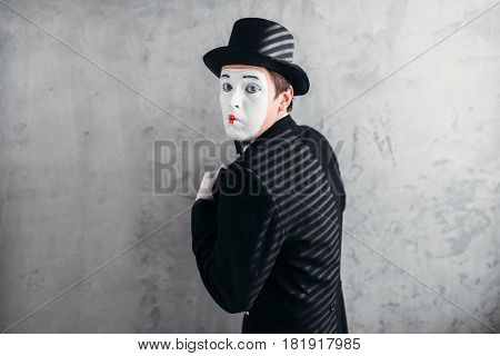 Male comedy artist posing, circus actor