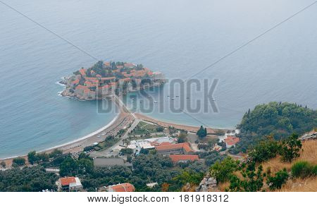 Island of Sveti Stefan, view from the church of Sveti Sava, at sunset. Montenegro, the Adriatic Sea, the Balkans.