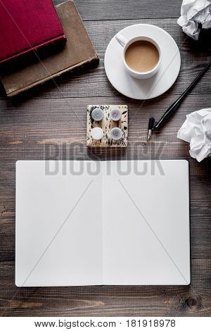 author office with cup in professional writer concept on wooden work desk background top view