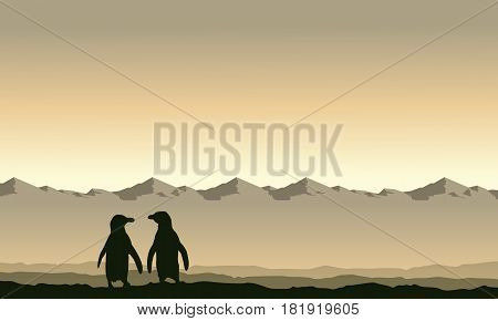 Silhouette penguin on mountain background scenery collection