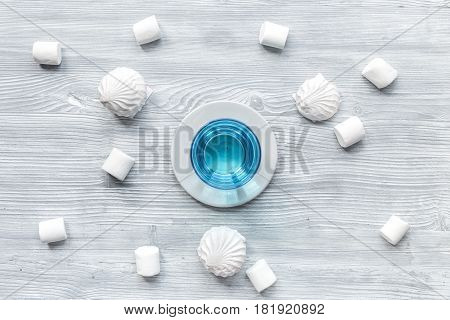sweet marsh-mallow and blue cocktail for woman breakfast concept on wooden desk background top view