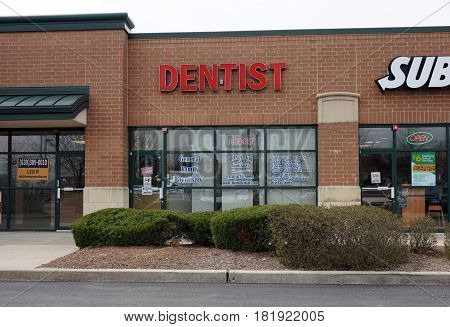 BOLINGBROOK, ILLINOIS / UNITED STATES - APRIL 14, 2017: One may obtain dental care from John S. Kim and Associates in the Concord Plaza in Bolingbrook.