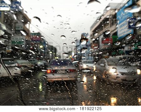 Soft Focus Of Water Drops On Car Glass With Traffic Jam Background, Traffic Jam In Songkran Festival
