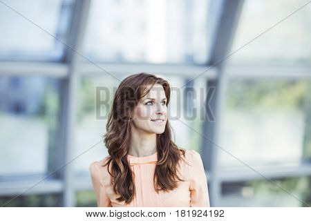 successful business woman on the background of the spacious office. the photo has a empty space for your text