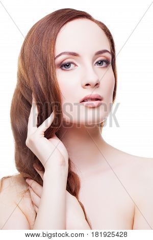 Beautiful young woman with pale skin and natural long red brown hair. Isolated on white background. Copy space.