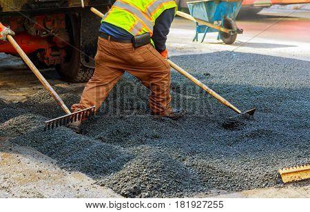 Men At Work, Urban Road Under Construction, Asphalting In Progress