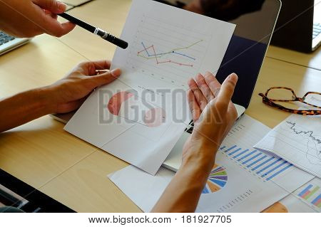 The above view of business meeting dicuss financial data