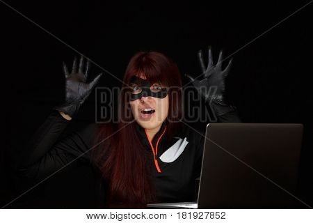 Woman spy with raised hands