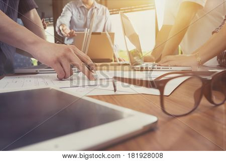 Business man hand pointing at business document during discussion at meeting.vintage tone